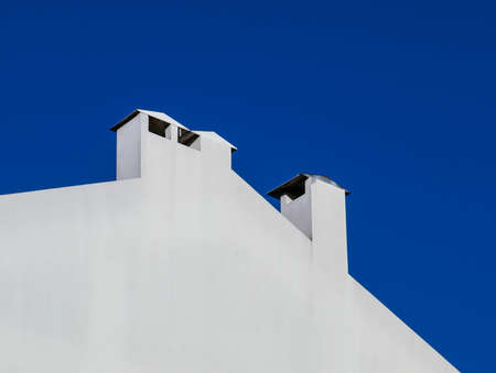 White chimneys and blue sky