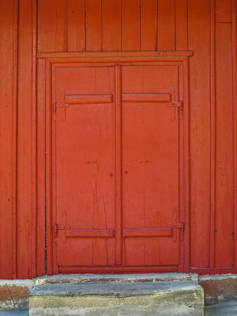 Old red door made of wood