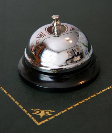 service bell: A service bell on a hotel reception desk