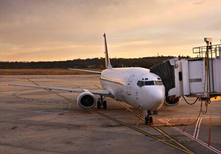 Plane at Melbourne Airport Terminal at Sunrise photo