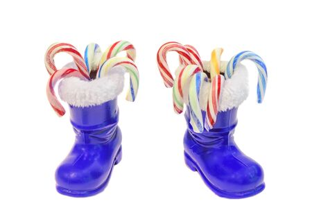 Blue Santa Claus boots, Saint Nicholas, with colored candies bars, isolated on white background.