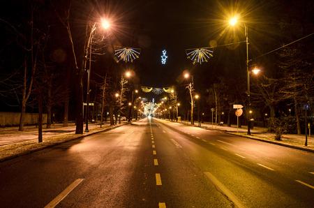 rumania: The Arch of Triumph (Arcul de Triumf) from Bucharest Romania, Christmas lights ornaments, view from Kisseleff Avenue.