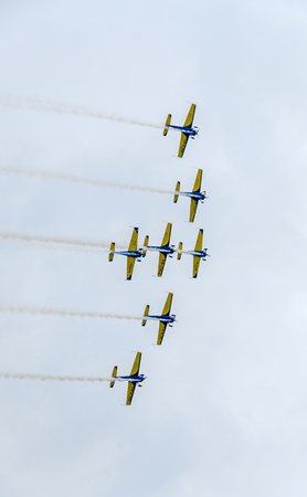BUCHAREST, ROMANIA - JULY 30, 2016. The Romanian Hawks Team pilots with their colored airplanes training in the blue sky.  Bucharest International Air Show.