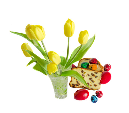 specific: Yellow tulips with cake called Pasca made with cheese and raisins, traditional colored easter eggs Stock Photo