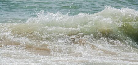 balchik: Blue, green water waves, Black Sea sandy shore, seaside with water foam, lather, close up