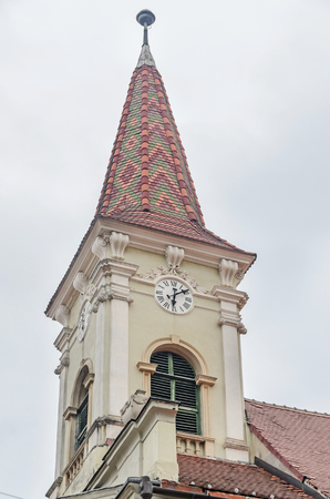 rumanian: SIBIU, ROMANIA - AUGUST 10, 2016: The Reformed Church, detail of the tower.