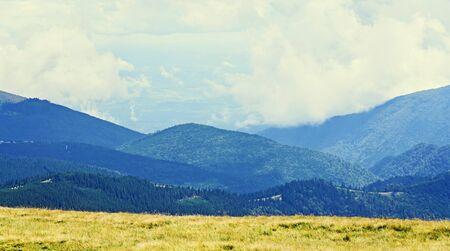Transalpina road, Parang Mountains near clouds, hills with green grass and rocks,  Carpathian Mountains. Stock Photo