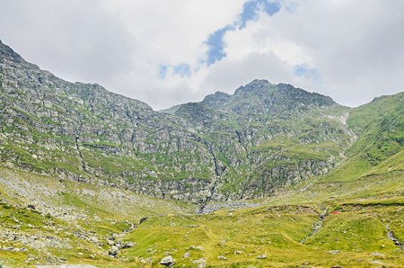 Fagaras mountains, Carpathians with green grass and rocks, Transfagarasan road