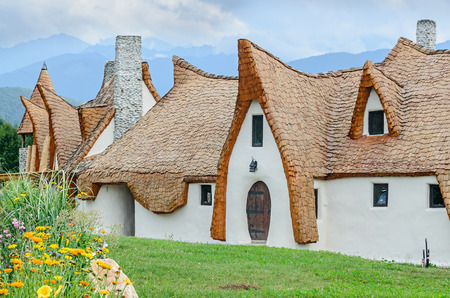 PORUMBACU DE SUS, ROMANIA - AUGUST 10, 2016: Clay Castle, The Valley of the Fairies (Castelul de Lut, Valea Zanelor), Transylvanian Hobbit hotel built out of clay and sand. Grimm houses.