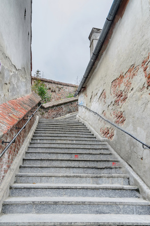 rumanian: SIBIU, ROMANIA - AUGUST 10, 2016: Stairs near downtown of the city. The connection between up city and down city Editorial