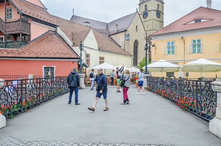 rumanian: SIBIU, ROMANIA - AUGUST 10, 2016: Liars Bridge near downtown with old colored houses Editorial