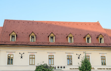 rumanian: SIBIU, ROMANIA - AUGUST 10, 2016: Detail of houses situated near downtown of the city. Roof with colored windows Editorial