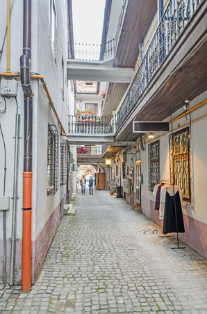rumanian: SIBIU, ROMANIA - AUGUST 10, 2016: The paved streets near downtown of the city. Colored houses