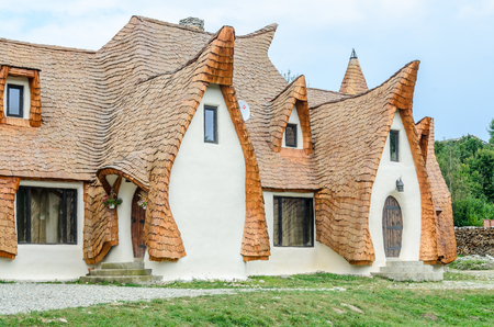 PORUMBACU DE SUS, ROMANIA - AUGUST 10, 2016: Clay Castle, The Valley of the Fairies (Castelul de Lut, Valea Zanelor), Transylvanian Hobbit hotel built out of clay and sand. Grimm houses