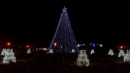public park at night time with vivid colored christmas lights stars trees lights