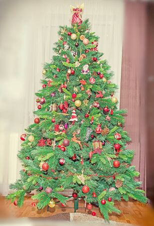 noe: Green Christmas tree with many vibrant colored ornaments, colored lights, decorated, close up, indoor, Christmas spirit