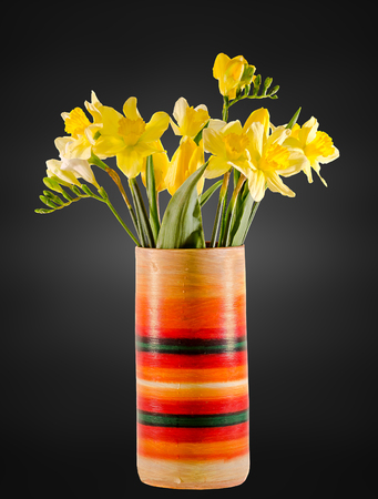 Yellow Daffodils And Freesias Flowers In A Colored Vase Close