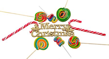 Yellow sparkley Merry Christams write, letters with colored candy sticks and lollipops, isolated Stock Photo
