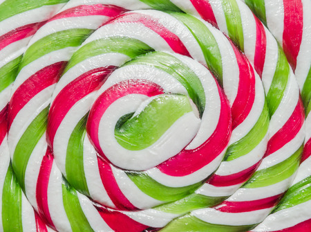 Vivid colored candy christmas sticks, lollipops, spiral shape, round, heart shape,  isolated, white background.