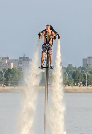 BUCHAREST, ROMANIA - SEPTEMBER 5, 2015. Acrobatic Jetsky pilot training on the lake. Aeronautic show. Editorial