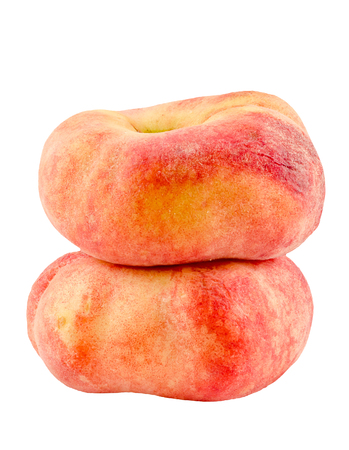 Saturn peaches, also known as Donut (Doughnut) peaches, are a variety of peach with white flesh and a flattish, round shape. Close up. Stock Photo