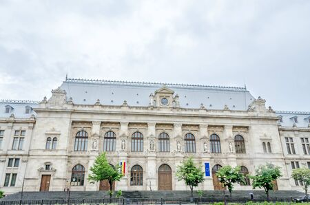 university fountain: BUCHAREST, ROMANIA - MAY 25, 2014: The Courthouse of Bucharest.