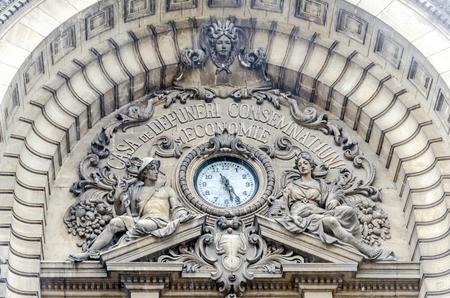university fountain: BUCHAREST, ROMANIA - MAY 25, 2014: The CEC Palace. Palatul CEC. Exterior clock detail. Build in 1900, design by Paul Gottereau.