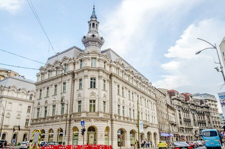 BUCHAREST, ROMANIA - MAY 25, 2014: Old vintage building from Victoria Avenue (Calea Victoriei)