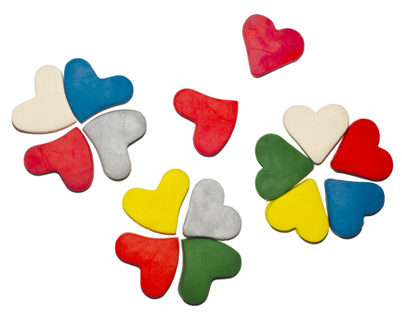 Clover colored hearts made from modelling clay.