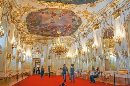 AUSTRIA, VIENNA - MAY 8, 2012. Visiting The Schonbrunn Palace, interior golden room Redakční