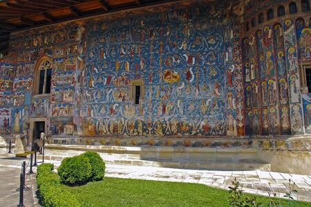 MOLDOVA, ROMANIA - JULY 4,  2014. Visiting the Monastery Voronet. Details of painted exterior walls. Dominant color is well known blue of Voronet. Editorial