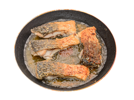 Carp fish meat fried in oil, crispy look, cooking pan close up. Stock Photo