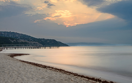 balchik: The Black Sea shore from Albena, Bulgaria with golden sands, sun, blue mystic water, seaside bridge near Kaliakra hotel. Stock Photo
