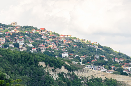 balchik: The Black Sea shore, green hills with houses, blue clouds sky. City Balchik coast.