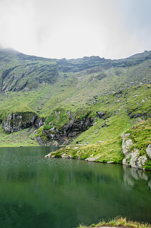 The glacier lake called Balea (Balea Lac) on the Transfagarasan road from Fagaras mountains. Stock Photo