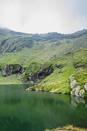 The glacier lake called Balea (Balea Lac) on the Transfagarasan road from Fagaras mountains. Imagens