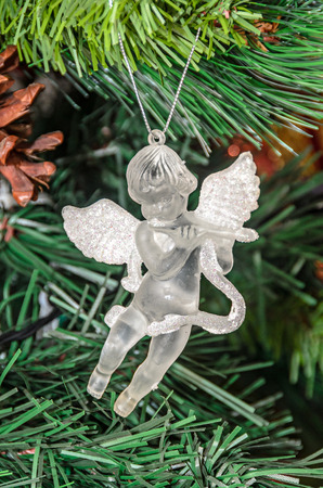 Christmas tree hanging ornament, transparent angel, close up. Imagens - 116869531