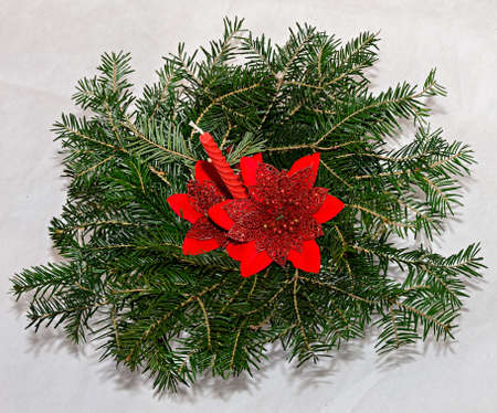 Fir tree christmas circle decoration with red candle