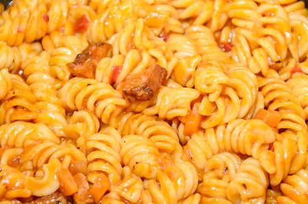 Pasta spaghetti with red tomato sauce,  arrabiata with mushrooms, bacon, parmezan. Banco de Imagens