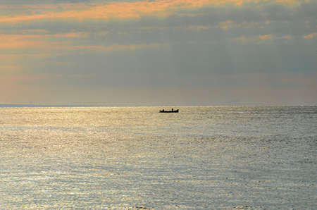 Fishermen boat on Black Sea near Golden Sands, Bulgaria sunrise. Banco de Imagens