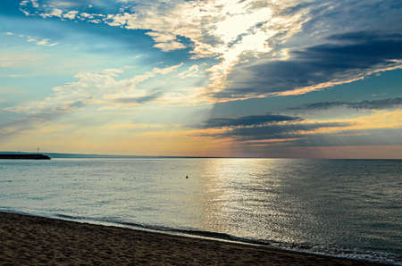 Beach of Black Sea from Golden Sands, Bulgaria with golden sands, blue clear water, fluffy clouds sky, sunrise.