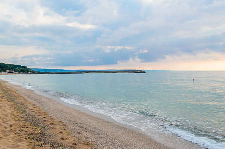 Beach of Black Sea from Golden Sands, Bulgaria with blue clear water, fluffy clouds sky, hotels Banco de Imagens