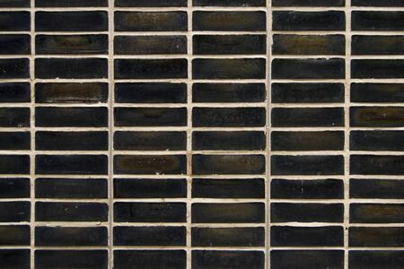 repetitive: black rectangular tiles wall, repetitive pattern