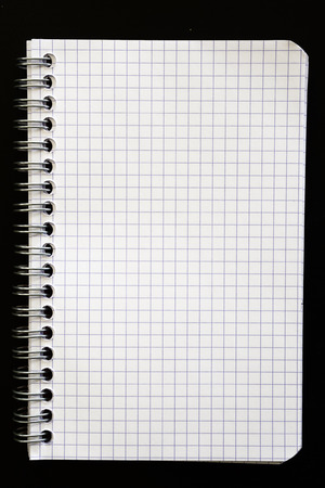 squared: squared paper spiral notebook. Background