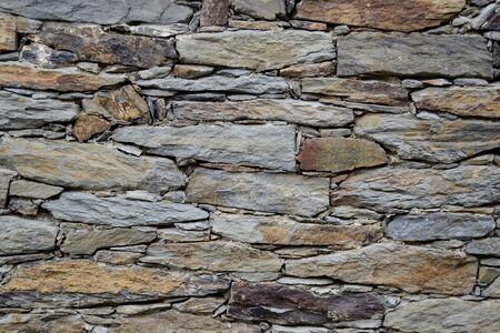 irregular shapes: stone wall stones with irregular shapes Stock Photo