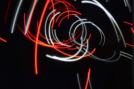 appoints: red and white lines black background light painting Stock Photo