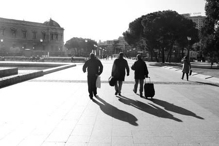 three persons: silhouette of three persons walking from backside Stock Photo