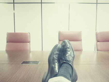 people relax: working hard, feet on a table