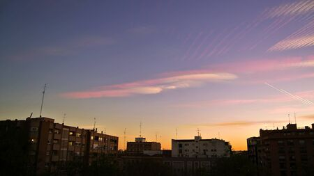 time lapse: urban landscape at twilight, with time lapse. Colorful sky over some buildings