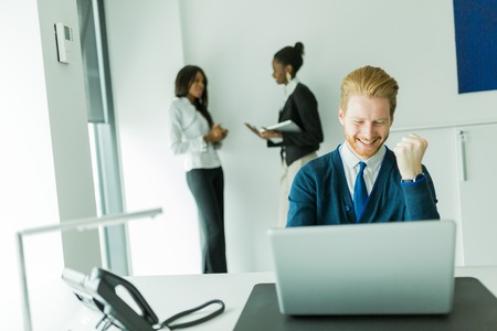sees: Successful businesman being happy for achieving his goals as he sees good news on the laptop Stock Photo